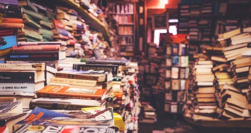 Disorganized stacks of books